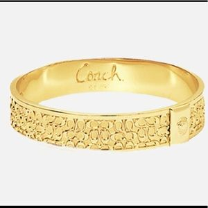 COACH Gold monogrammed C's Bangle